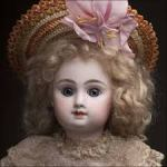 old fashioned doll with bonnet