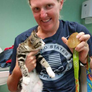 Olympian with cat and medal