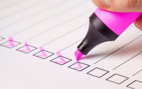 checklist with pink pen